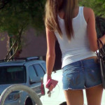 hot brunette bartender in tiny denim shorts