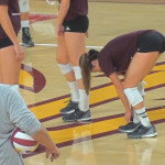 college girl bending over in volleyball shorts