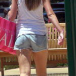 Hot blonde shopper in denim shorts