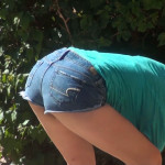 Thick busty babe bending over in tiny shorts
