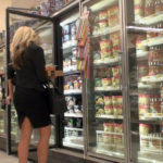 Rich blonde babe at supermarket in black skirt