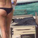Brunette Sunbather in Black Thong