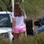 tan brunette teen in pink cheeky shorts