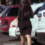 Brunette business woman in tight black skirt