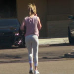 Blonde girl in white leggings