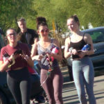 3 teen girls going to the gym in yoga pants