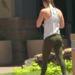 Athletic babe in tight green yoga pants